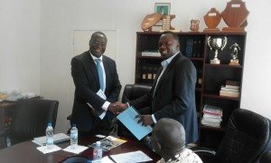 MSL Managing Director Dr. Bonface Fundafunda shakes hands with KZF's John Msimuko after signing the MoU