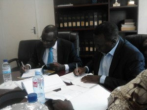 The heads of MSL and KZF signing the MoU for distribution of Kit Yamoyo through the public sector medical supply chain